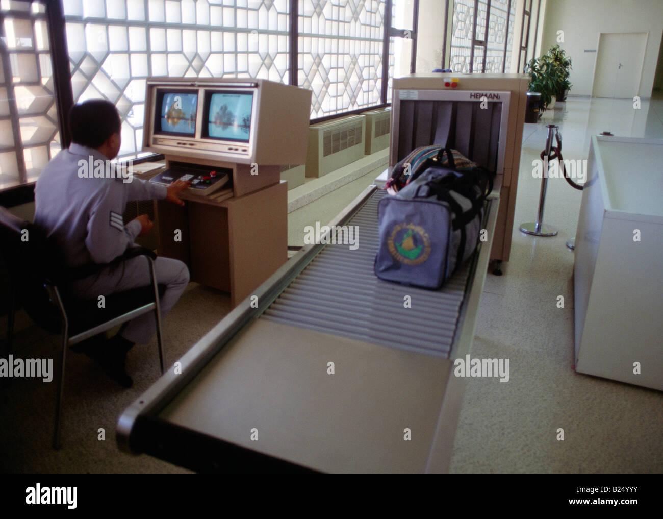 Abu Dhabi UAE International Airport Baggage Security Check X-ray Scanners Stock Photo