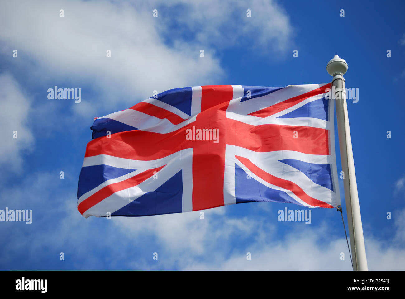 Union Jack flying on flagpole, Westminster, London, England, United Kingdom - Stock Image