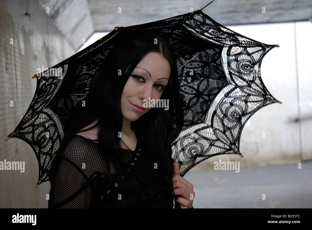 Portrait of a young female goth in an urban underpass - Stock Image