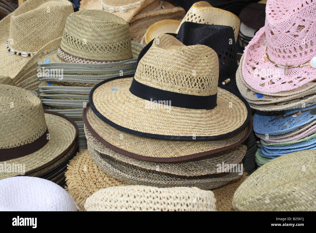 44be5f4ba5de6 piled straw hats on outdoor market stall at Tollwood summer music festival  Munich