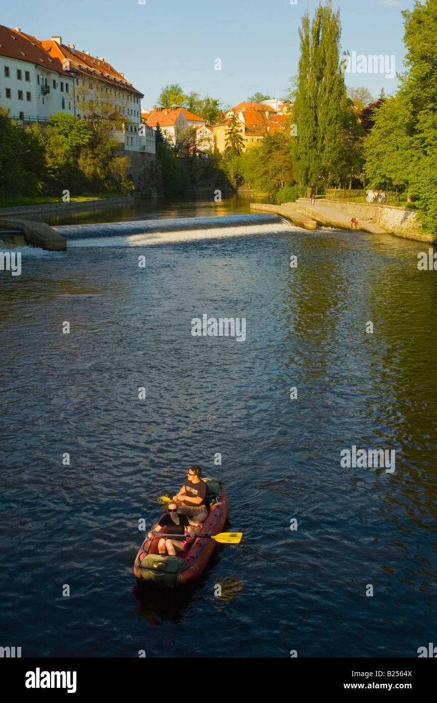 A couple rafting in River Vltava in Cesky Krumlov Czech Republic Europe - Stock Image
