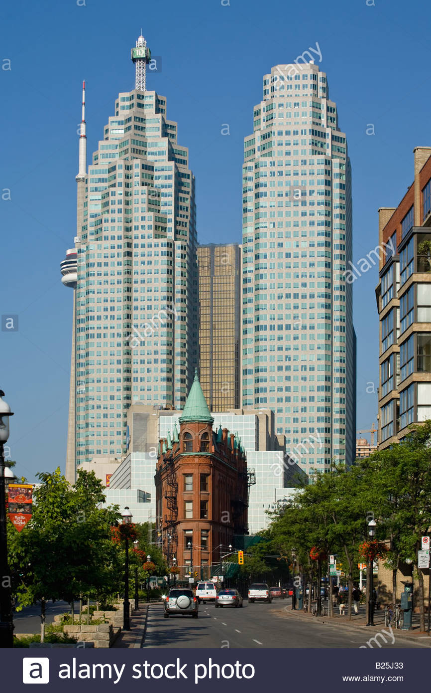 The red Gooderham Building with the relatively new twin towers of Brookfield Place on Front Street in Toronto Ontario - Stock Image