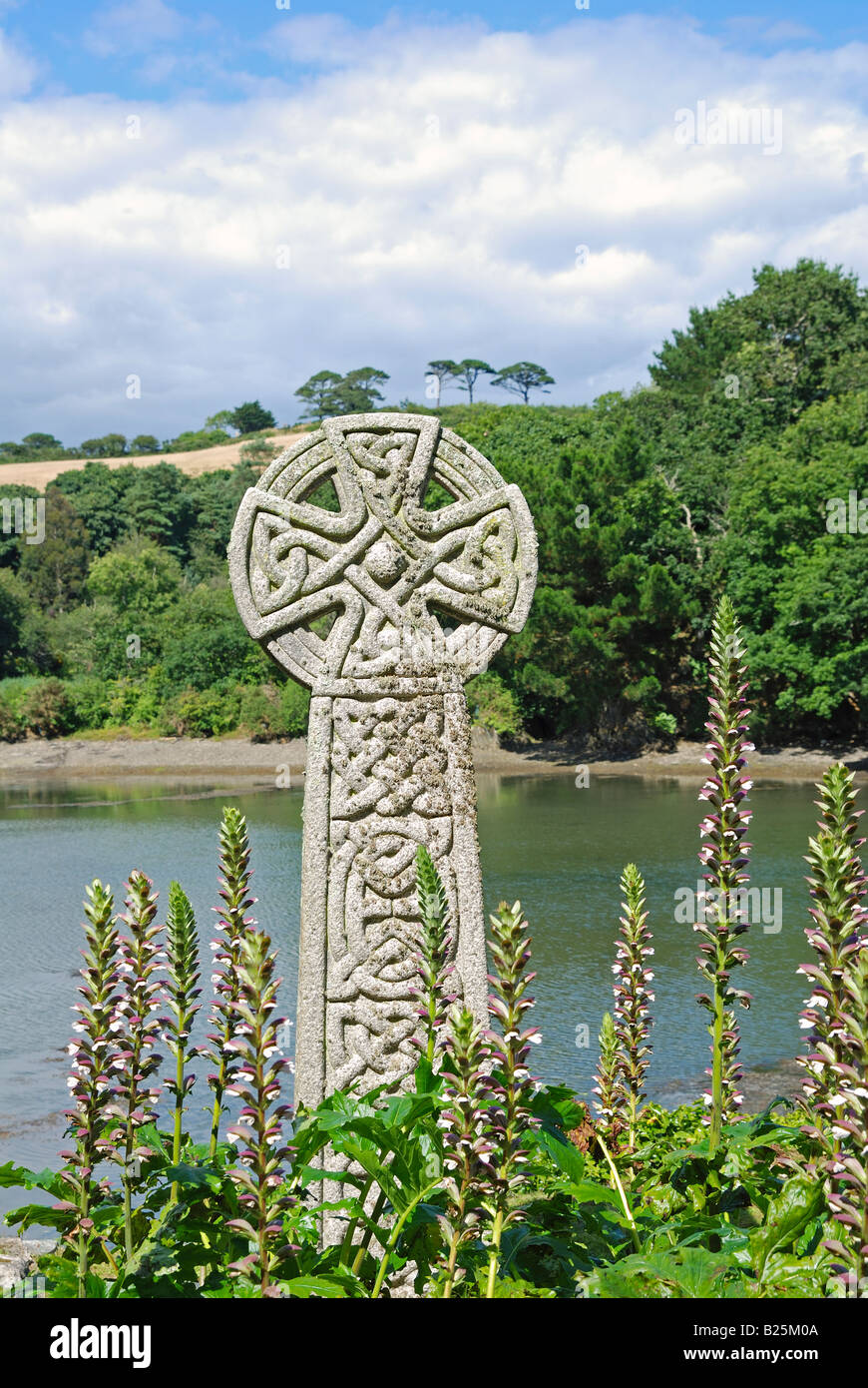 a celtic cross by a creek on the roseland peninsula,cornwall,uk - Stock Image