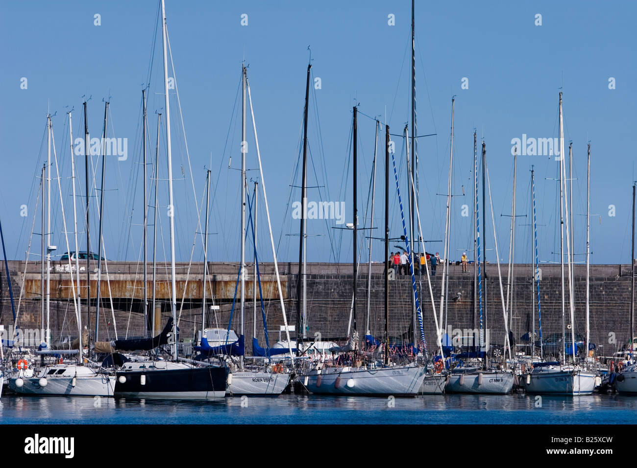 Yachts are seen in the bay of Catania, Sicily, Italy - Stock Image
