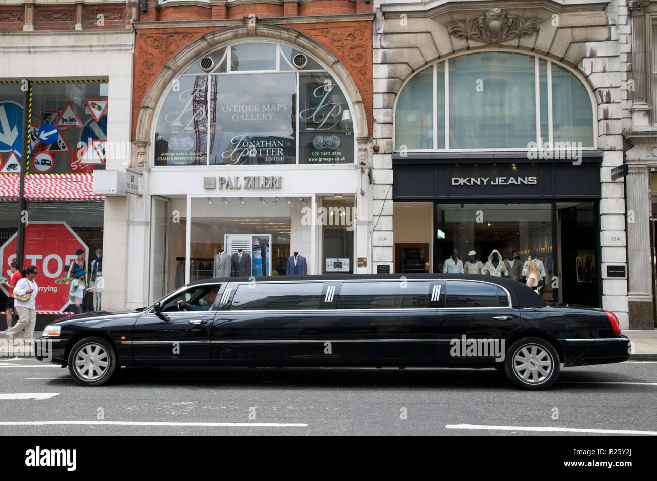 Stretch limousine in New Bond Street London England UK - Stock Image