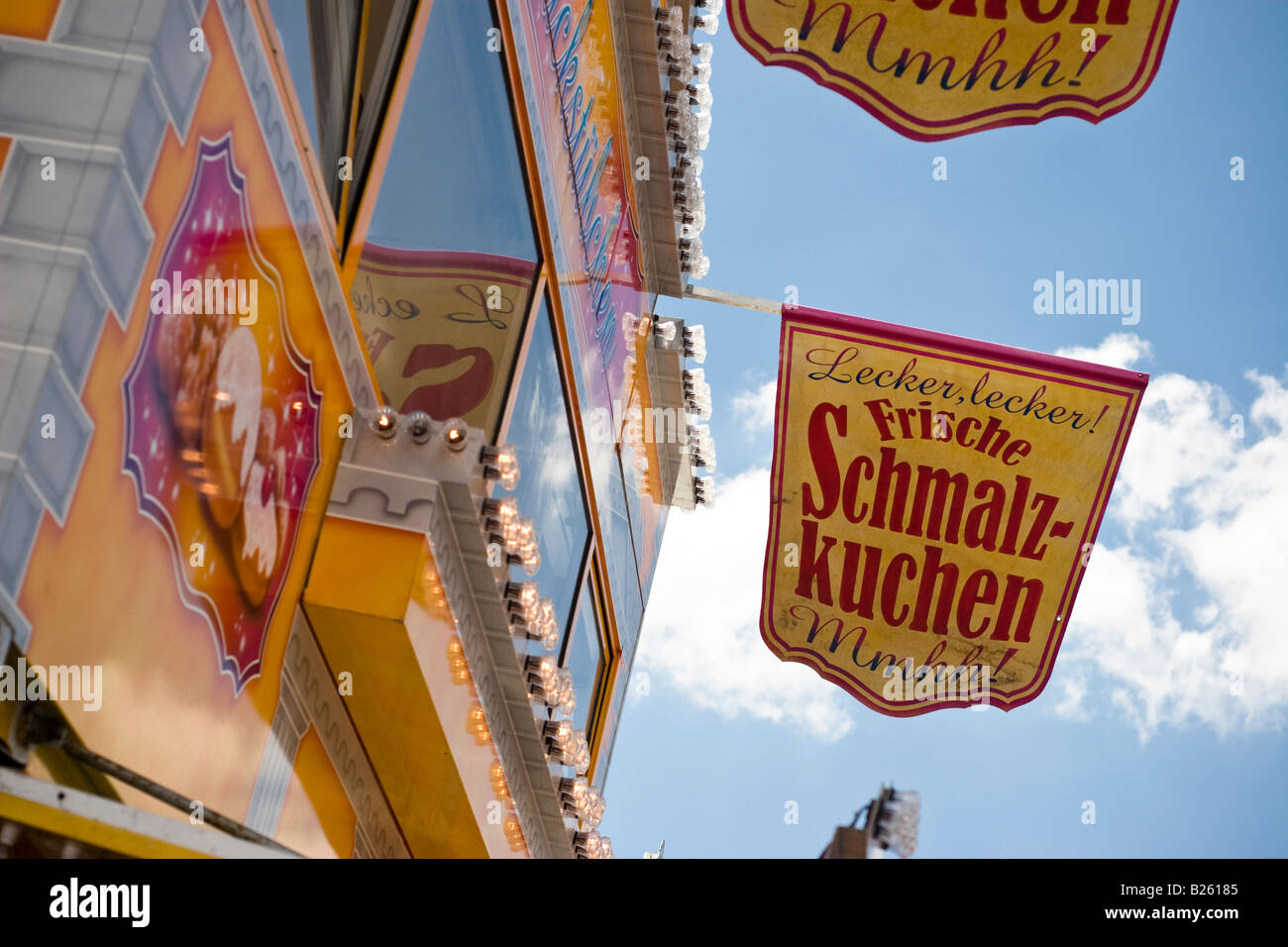 Sign advertising Schmalzkuchen a local culinary speciality at Hafengeburtstag a street party in the harbour of Hamburg, Stock Photo