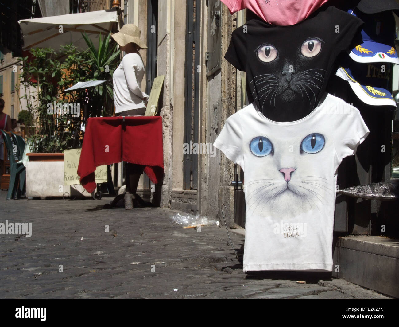 69fbe147 cat face t shirts for sale in gift shop stall stand in rome, italy ...
