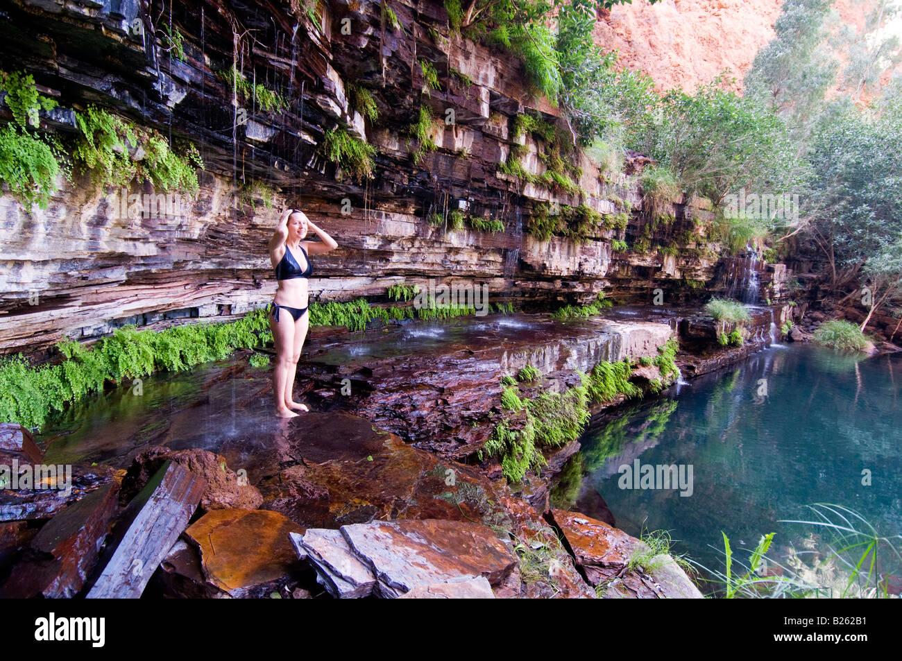 Waterfall Shower At Circular Pool In Karijini National Park Western Australia