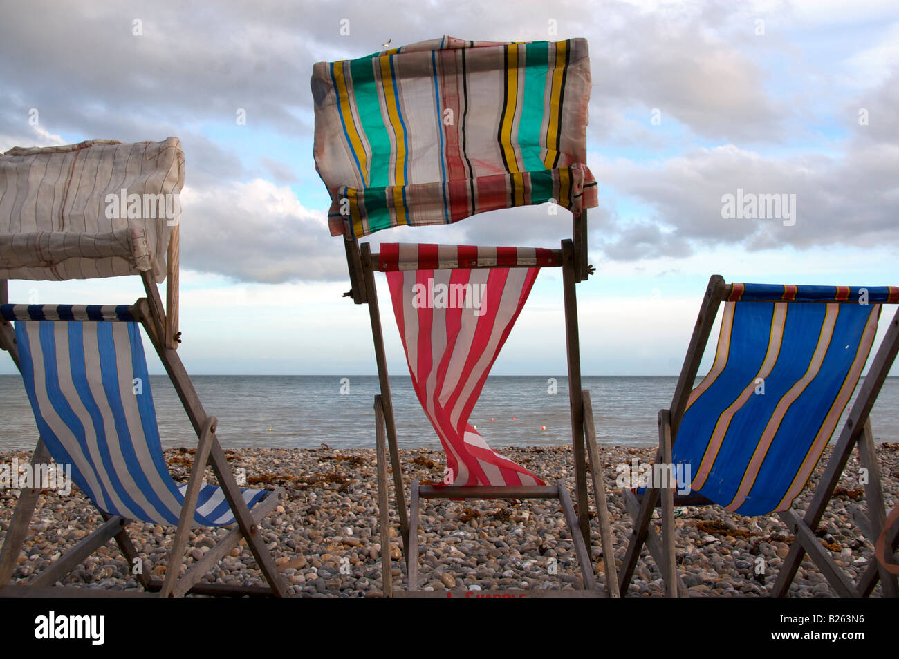 Deckchairs on the beach in Beer, Devon - Stock Image