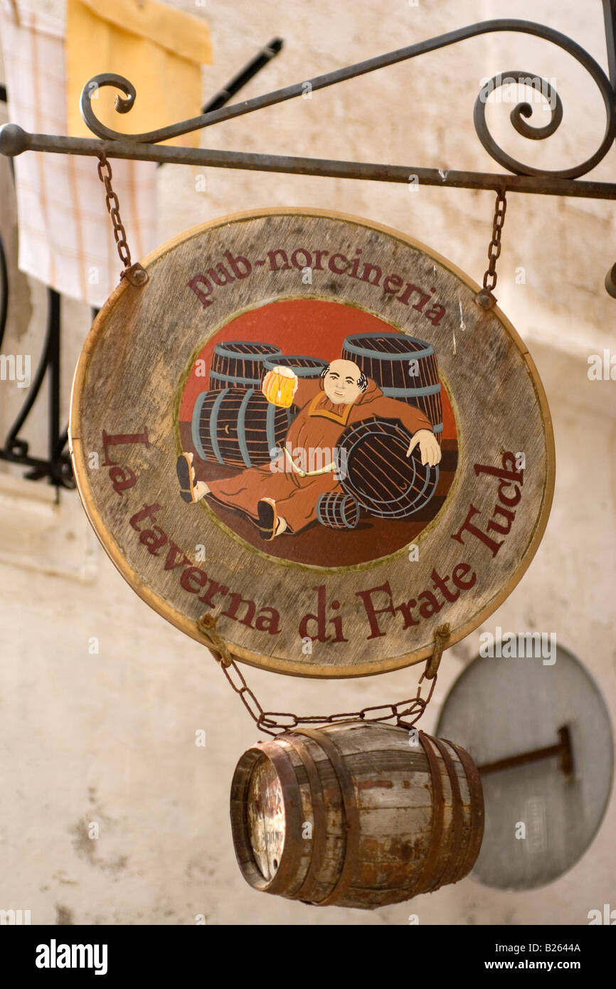 A pub sign showing Friar Tuck in the town of Polignano, Italy. The Robin Hood legend is well known even in southern - Stock Image