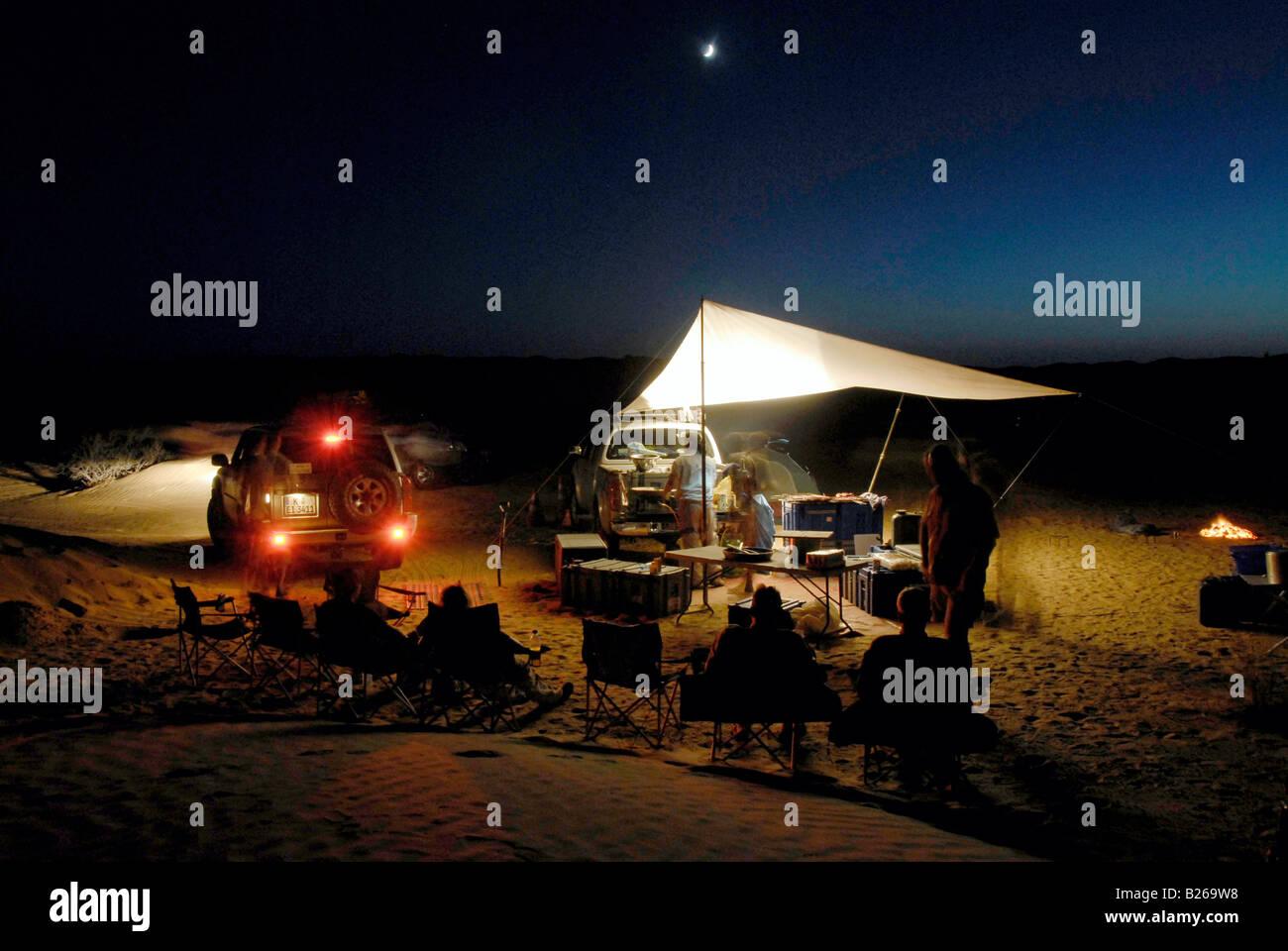 A group of people camping in the desert, Offroad 4x4 Sahara Desert Tour, Bebel Tembain area, Sahara, Tunisia, Africa, - Stock Image