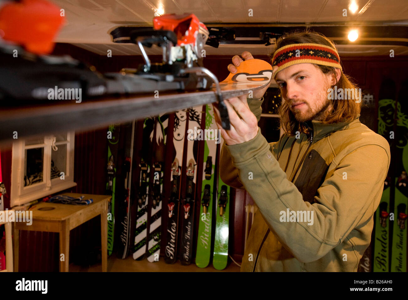 Man checking freeride ski, Andermatt, Canton Uri, Switzerland - Stock Image