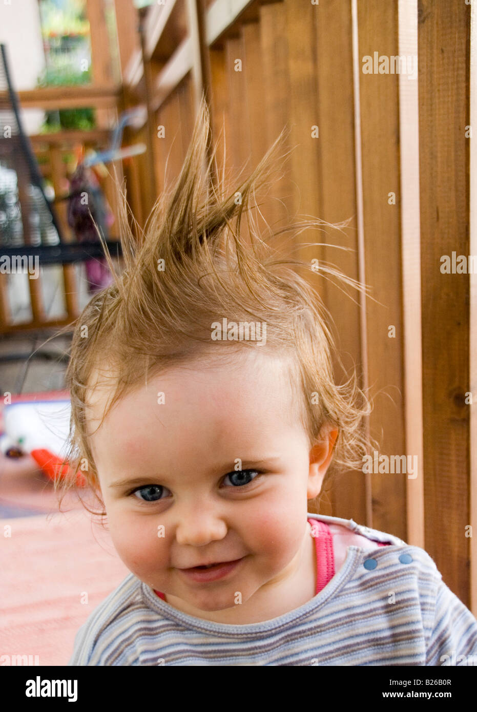 Prime Blonde Baby Girl Smiling With Funny Hair Stock Photo 18580039 Alamy Natural Hairstyles Runnerswayorg