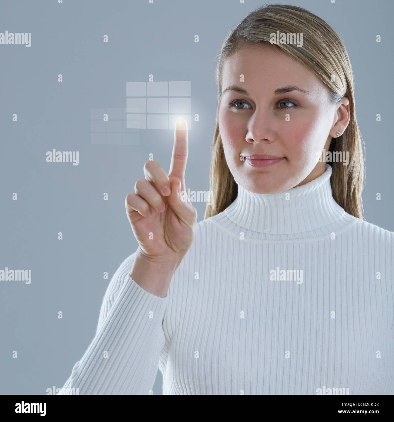 Woman touching lighted display - Stock Image