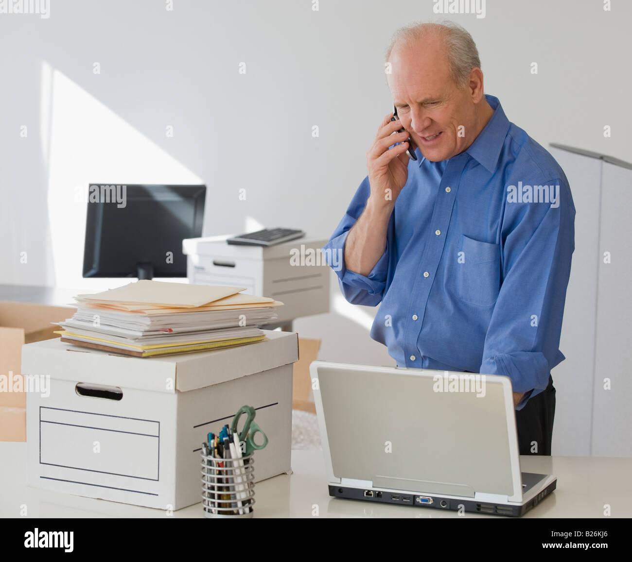 Senior businessman talking on cell phone - Stock Image