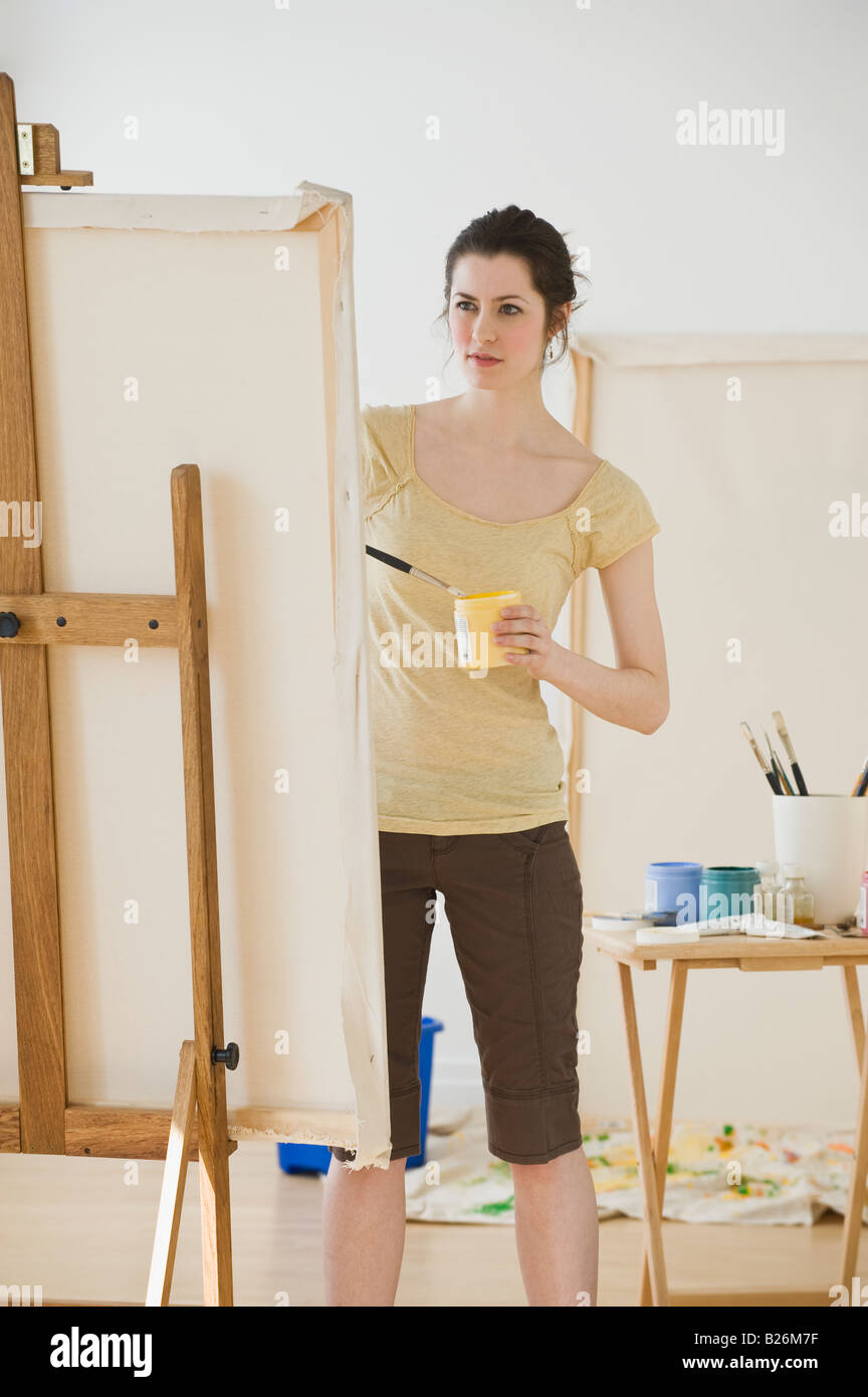 Woman painting on easel Stock Photo