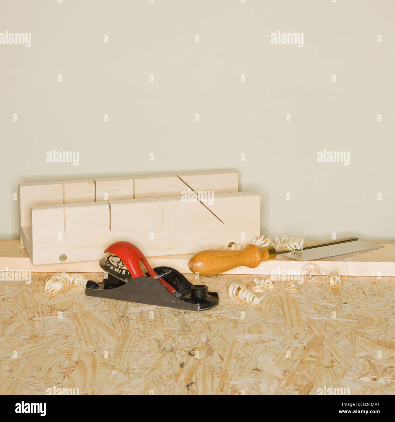 Woodworking plane and awl next to wood blocks - Stock Image