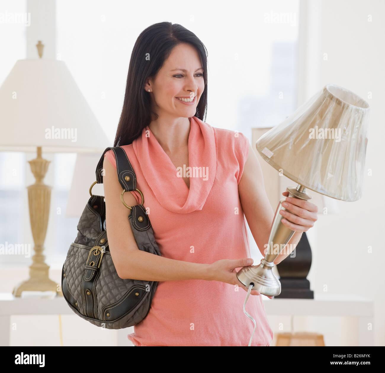 Woman shopping for lighting - Stock Image