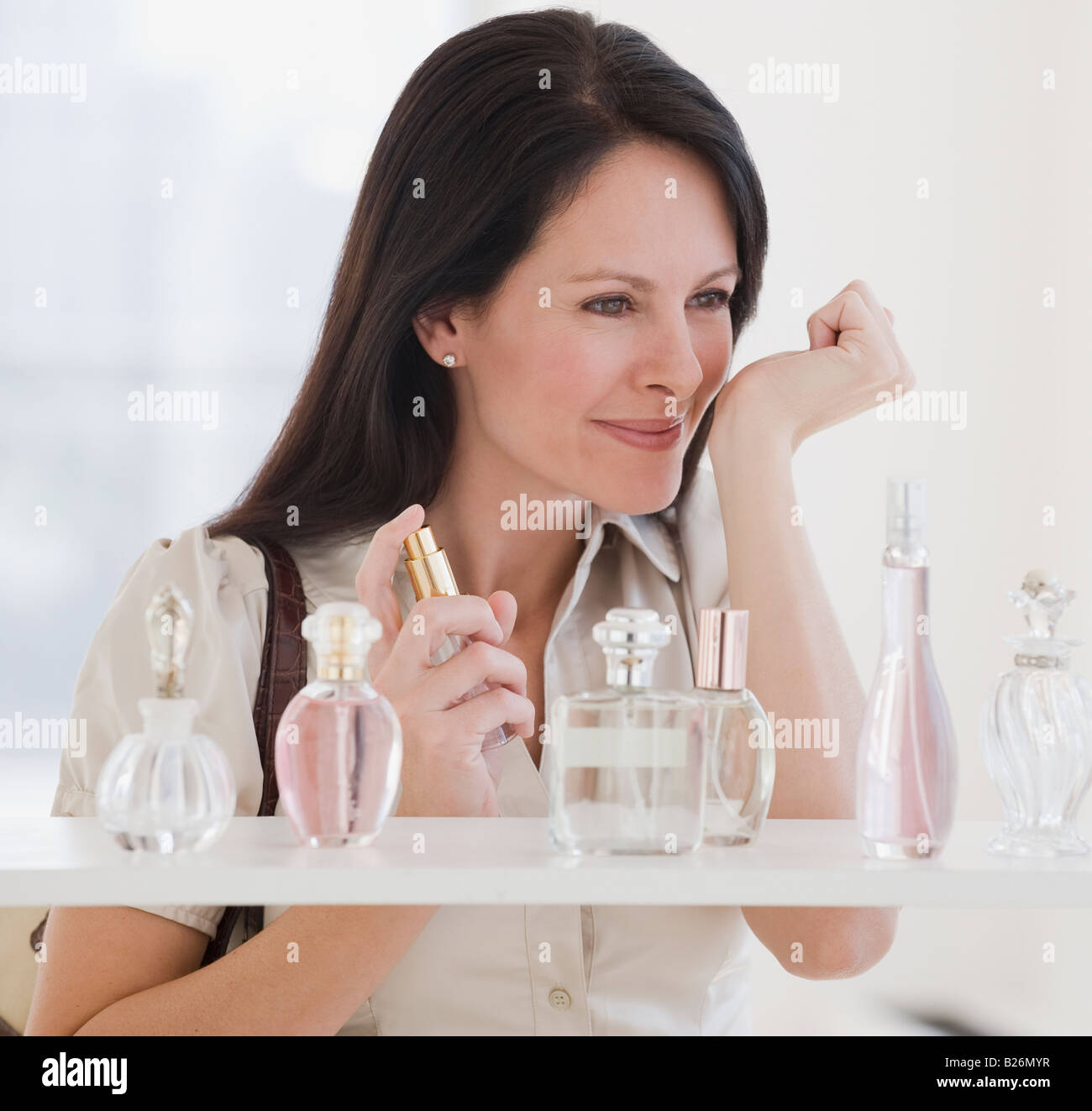 Woman sampling perfume - Stock Image