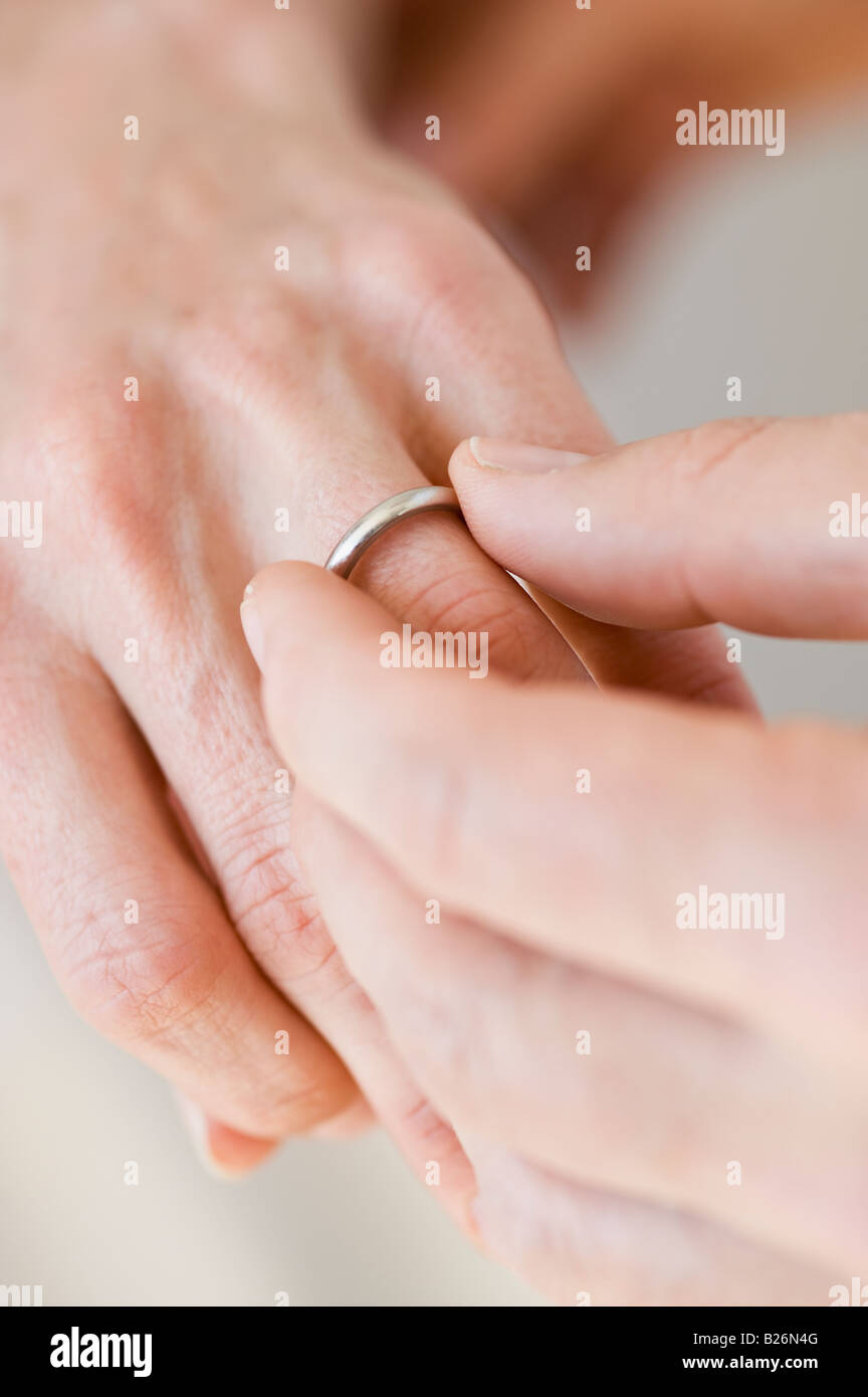 Man putting wedding ring on woman\'s finger Stock Photo: 18587984 - Alamy