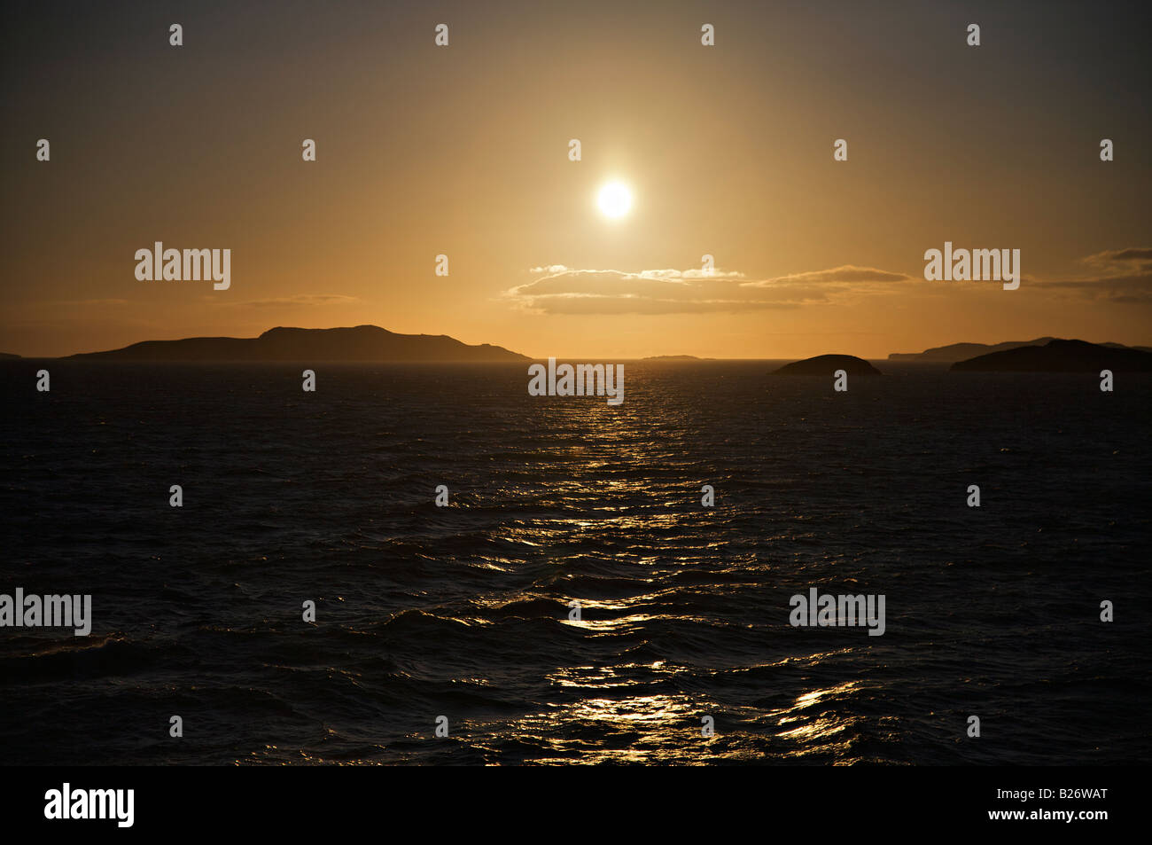 Golden sunset across the North Minch to Lewis and Stornoway Stock Photo