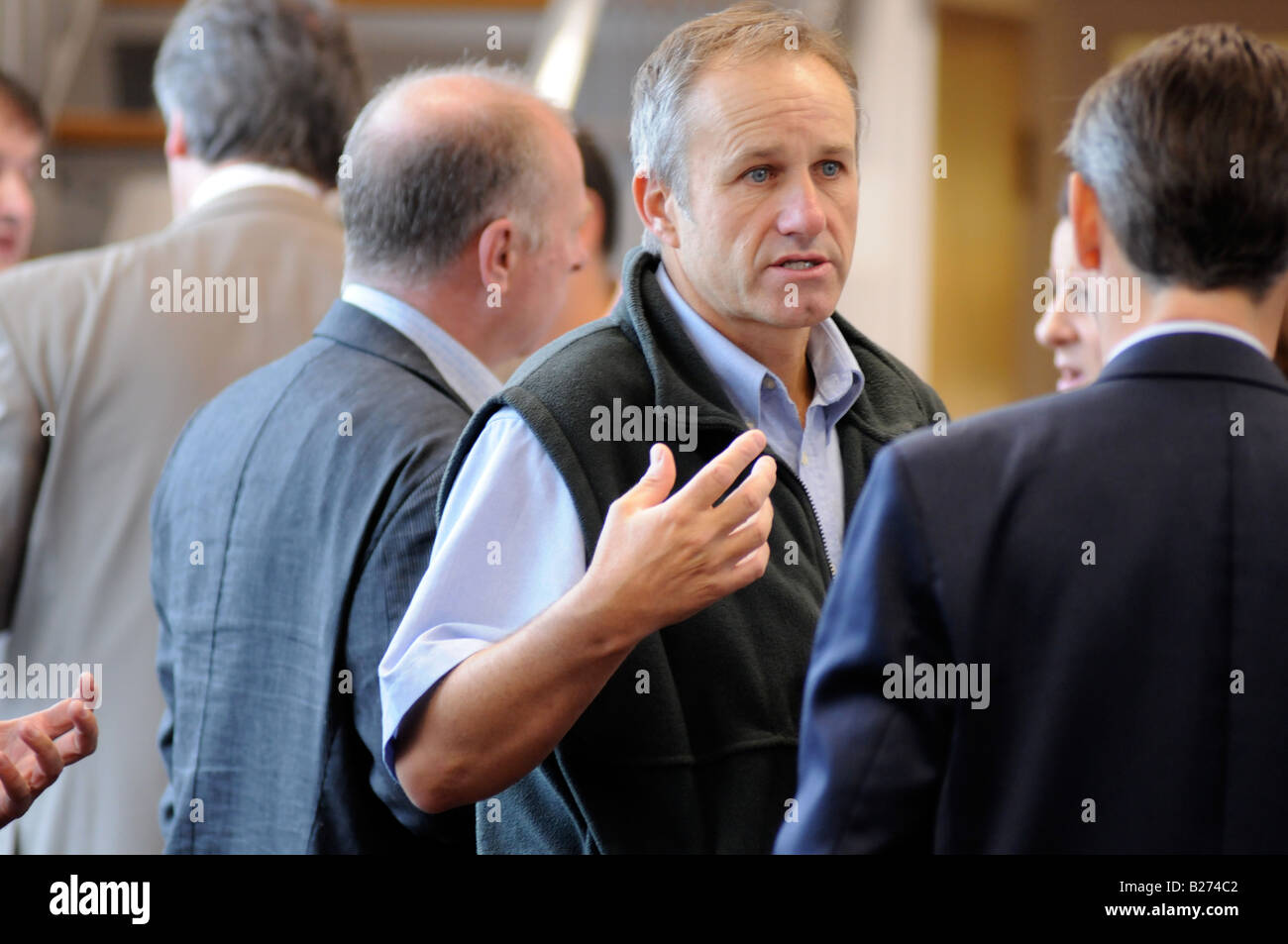 Royalty free photograph of a British business men in meeting talking and networking in corporate offices London - Stock Image