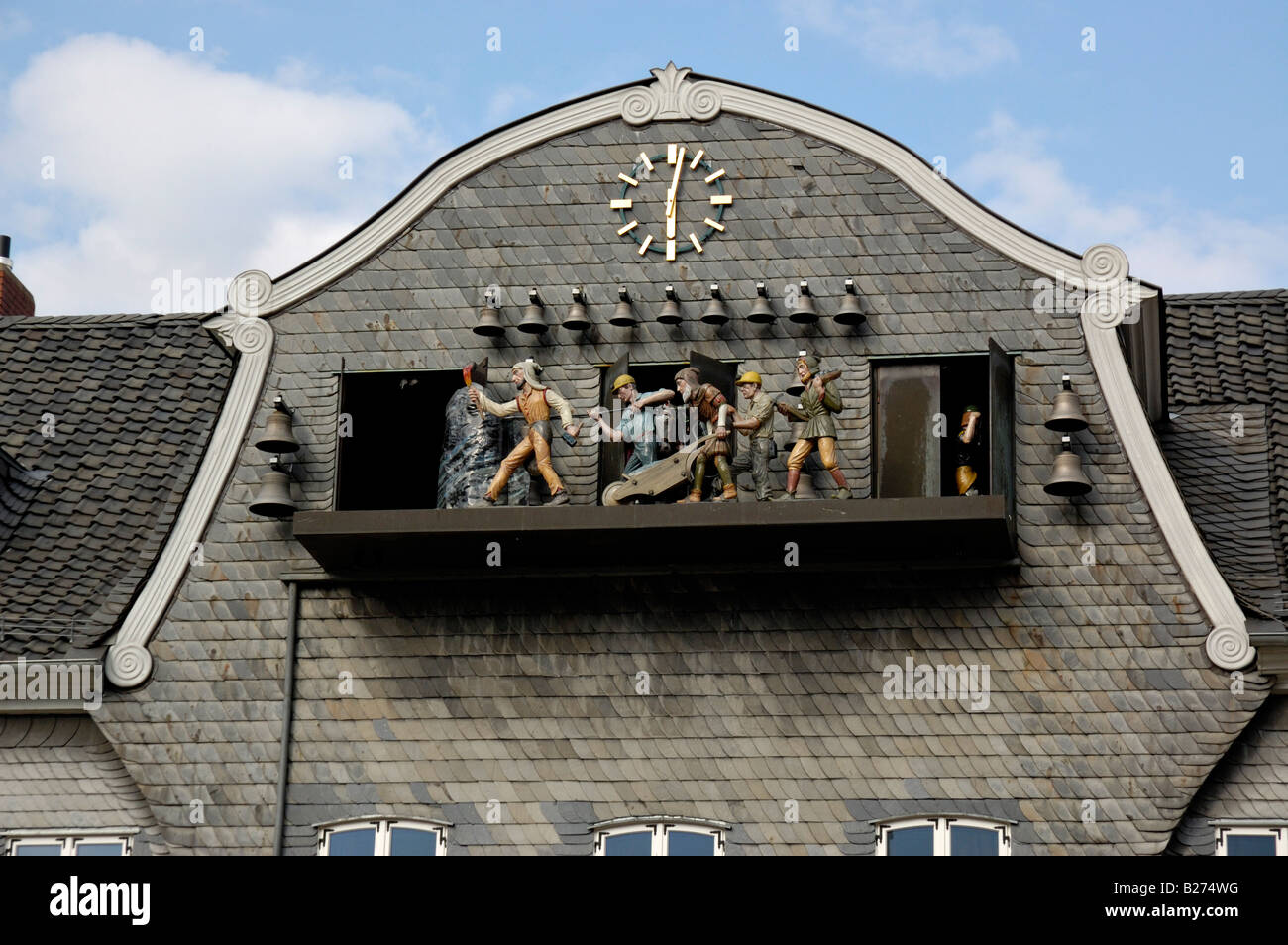 The clock on the Kaiserringhaus, Market Square in Goslar, Lower Saxony, Germany. Stock Photo