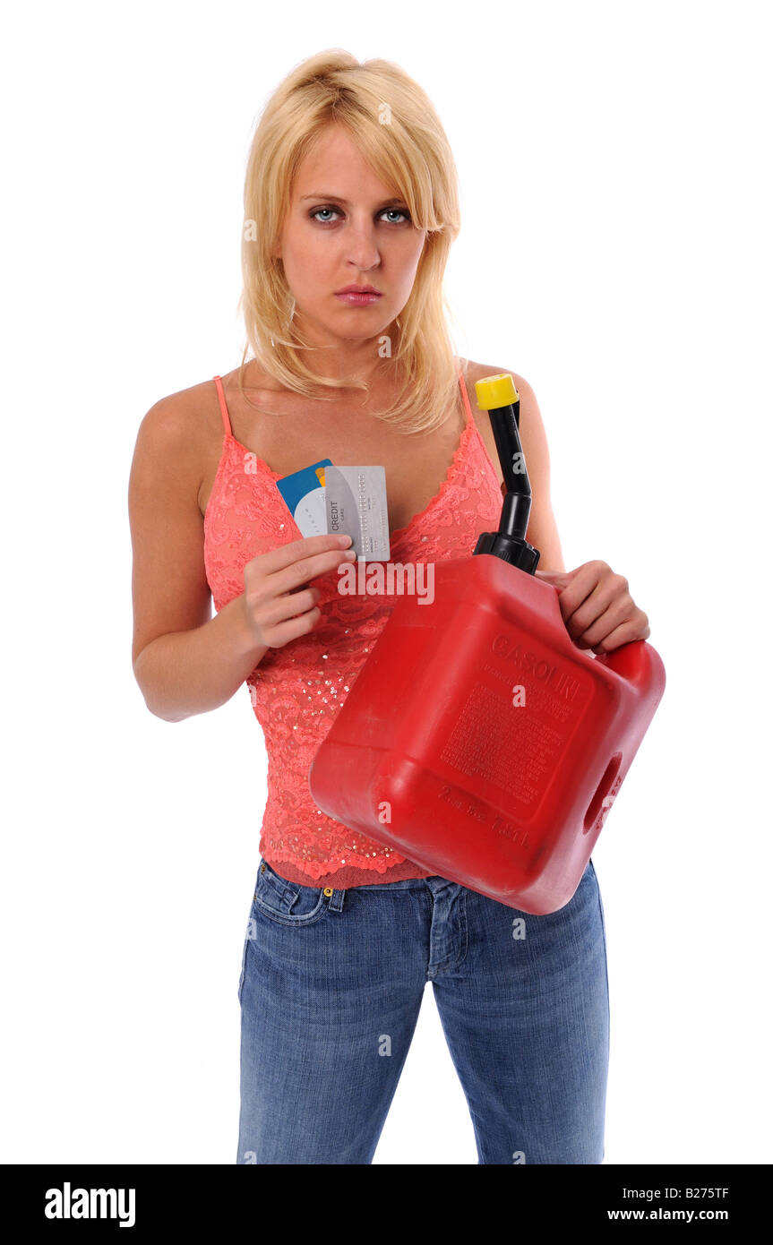 Woman holding gasoline can and credit cards isolated over a white background - Stock Image