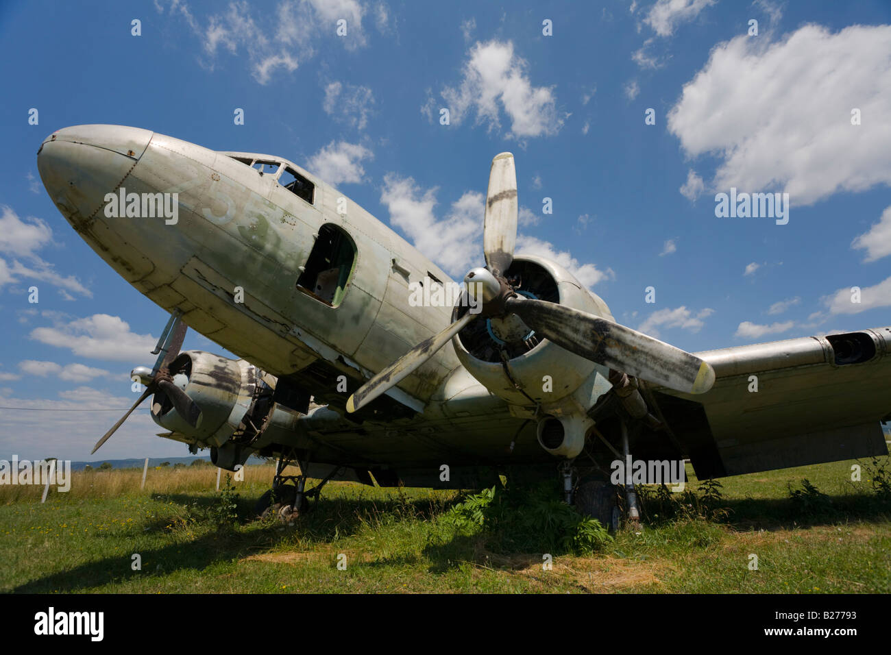 Derelict aircraft, C-47 Skytrain piston-engined propeller driven classic transport of ex JRV in Otocac, Croatia - Stock Image