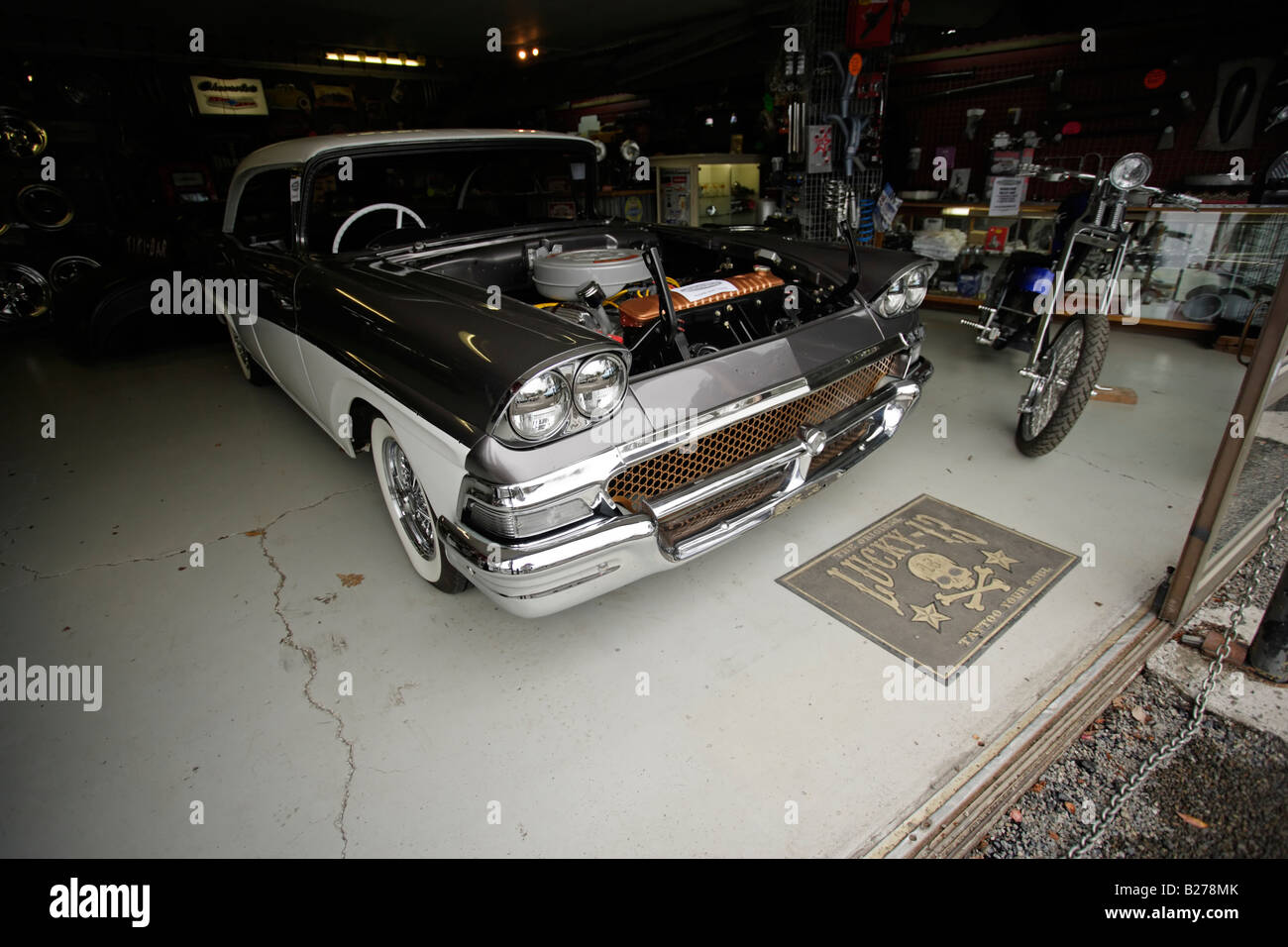 Custom cars at a workshop showroom in New Zealand Old Ford Stock ...