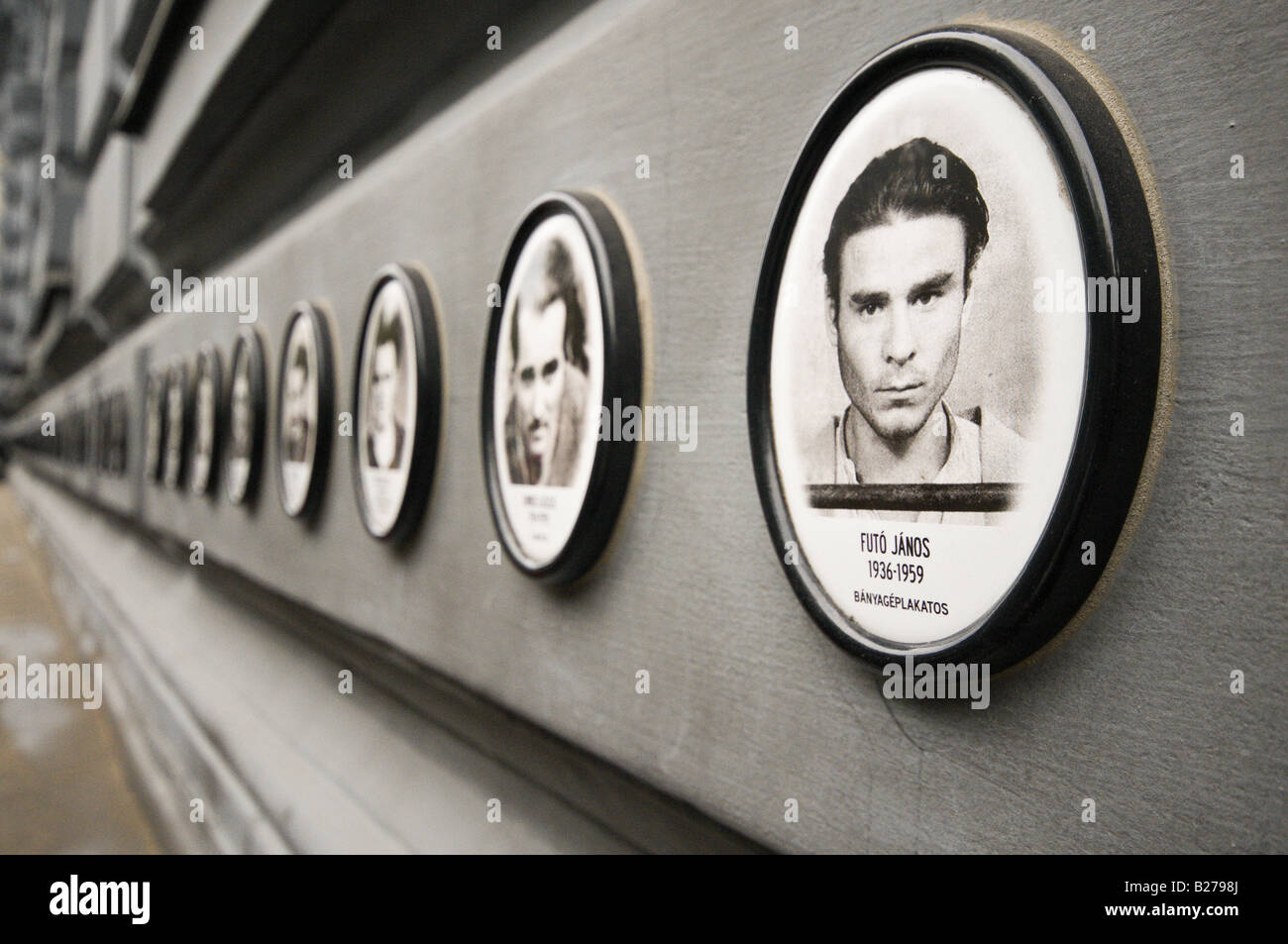 Plaques outside House of Terror, Budapest, showing victims of the Nazi, Arrow Cross and Soviet Communist occupation - Stock Image