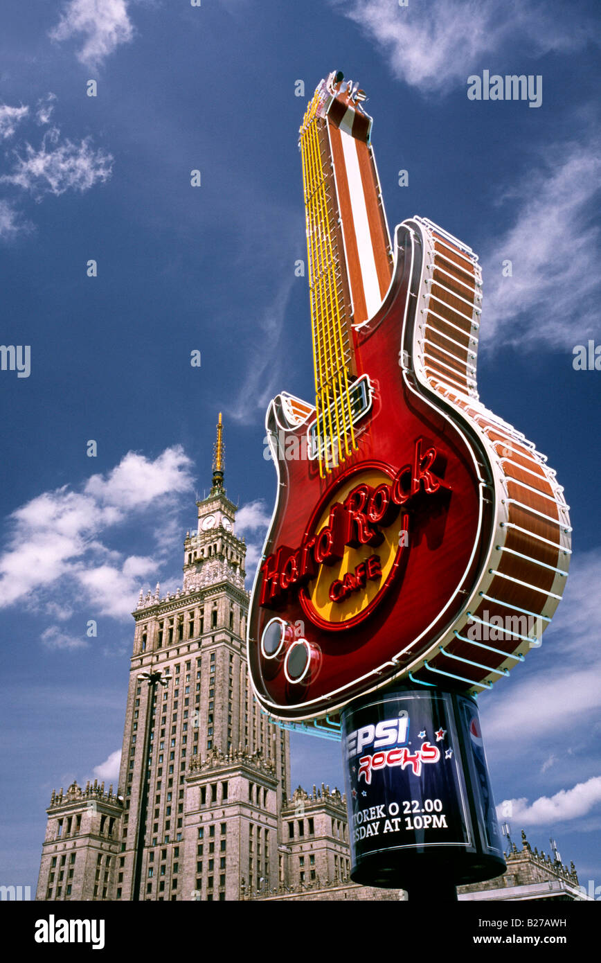 East meets West: Hard Rock Cafe and the Palace of Culture and Science in the Polish capital of Warsaw. - Stock Image