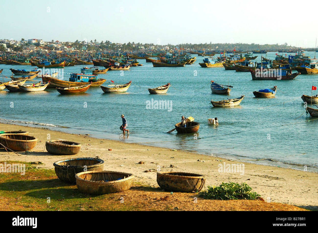 Fishing boats are moored at the fishing beach of Mui Ne, Viet Nam, Southeast Asia - Stock Image