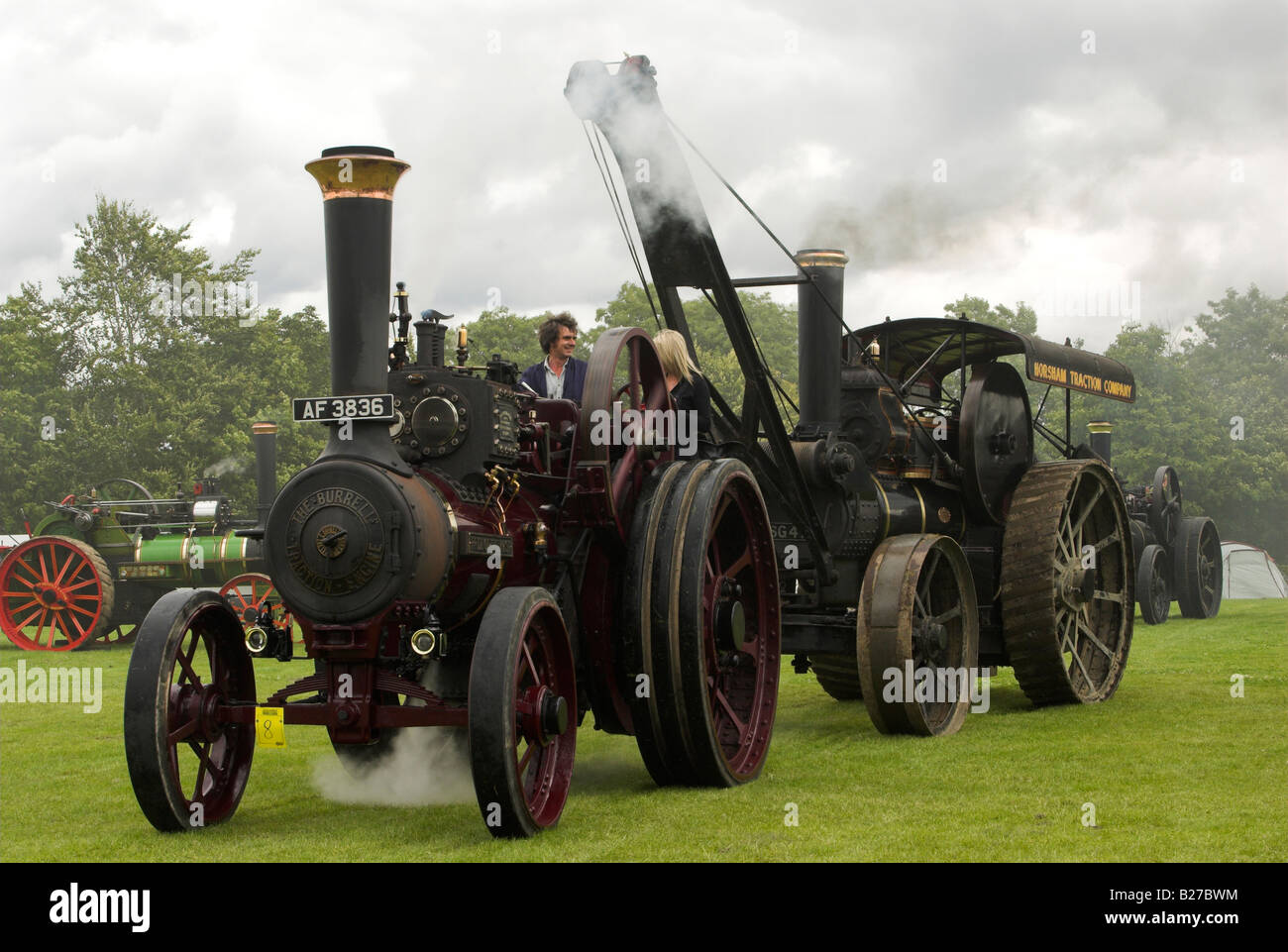 A Burrell 6nhp General Purpose Traction Engine built in 1916 tows a Fowler B5 8nhp Crane Engine built in 1901. - Stock Image