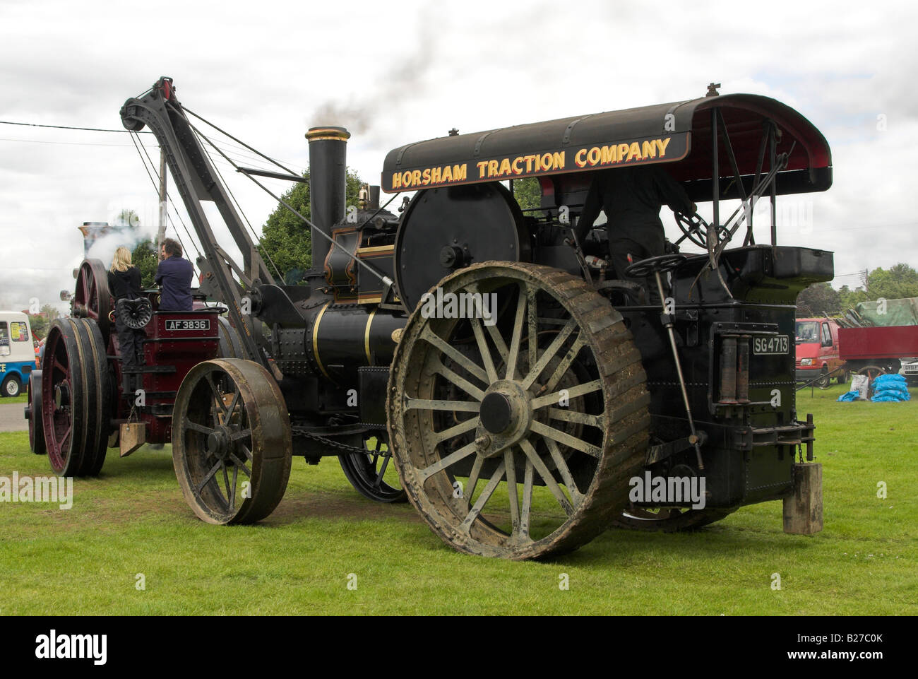 A Fowler B5 8nhp Crane Engine built in 1901 being towed by a Burrell 6nhp General Purpose Traction Engine built - Stock Image