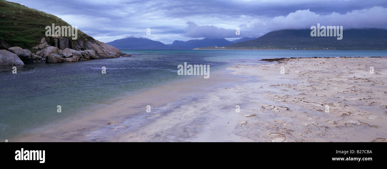 Small river runs out to sea at Traigh Niosaboist beach, Horgabost, Harris, Western Isles, Scotland, showing the - Stock Image