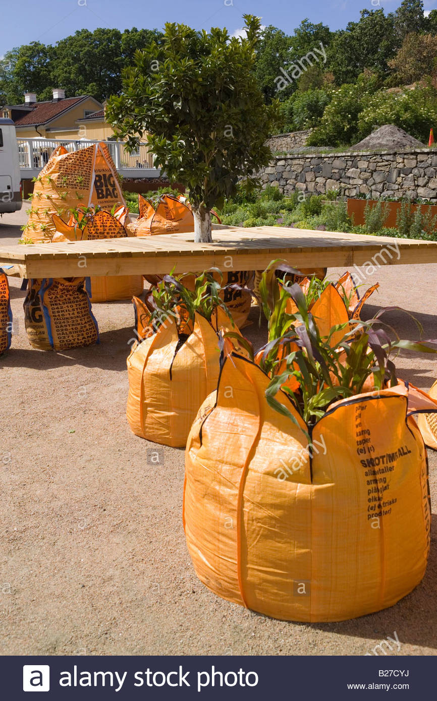 Shipping News Installation by Topher Delaney USA Large orange builders bags used to grow corn bay at Gunnebo Garden - Stock Image