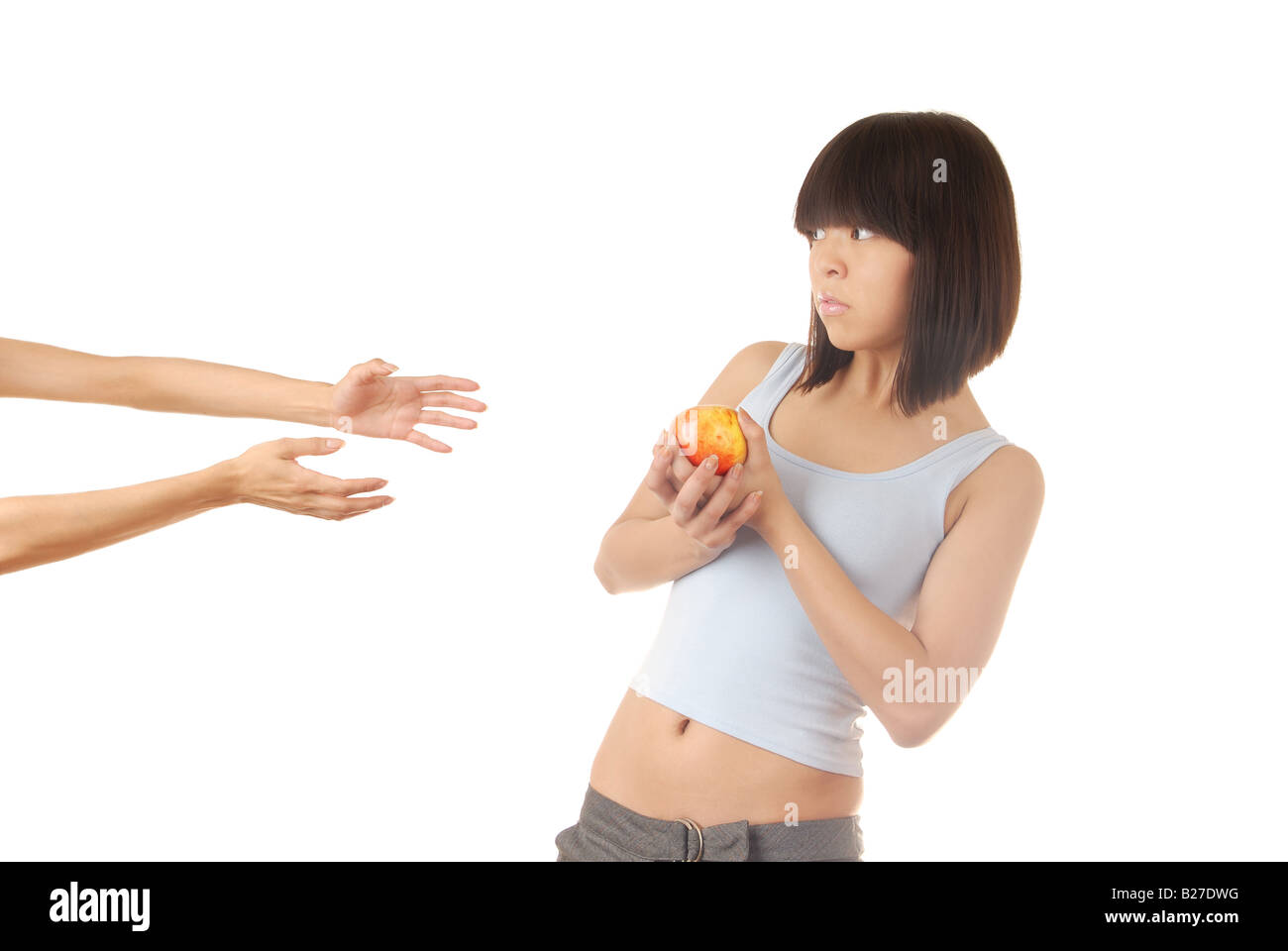Young lady with apple and two hands asking to help Stock Photo