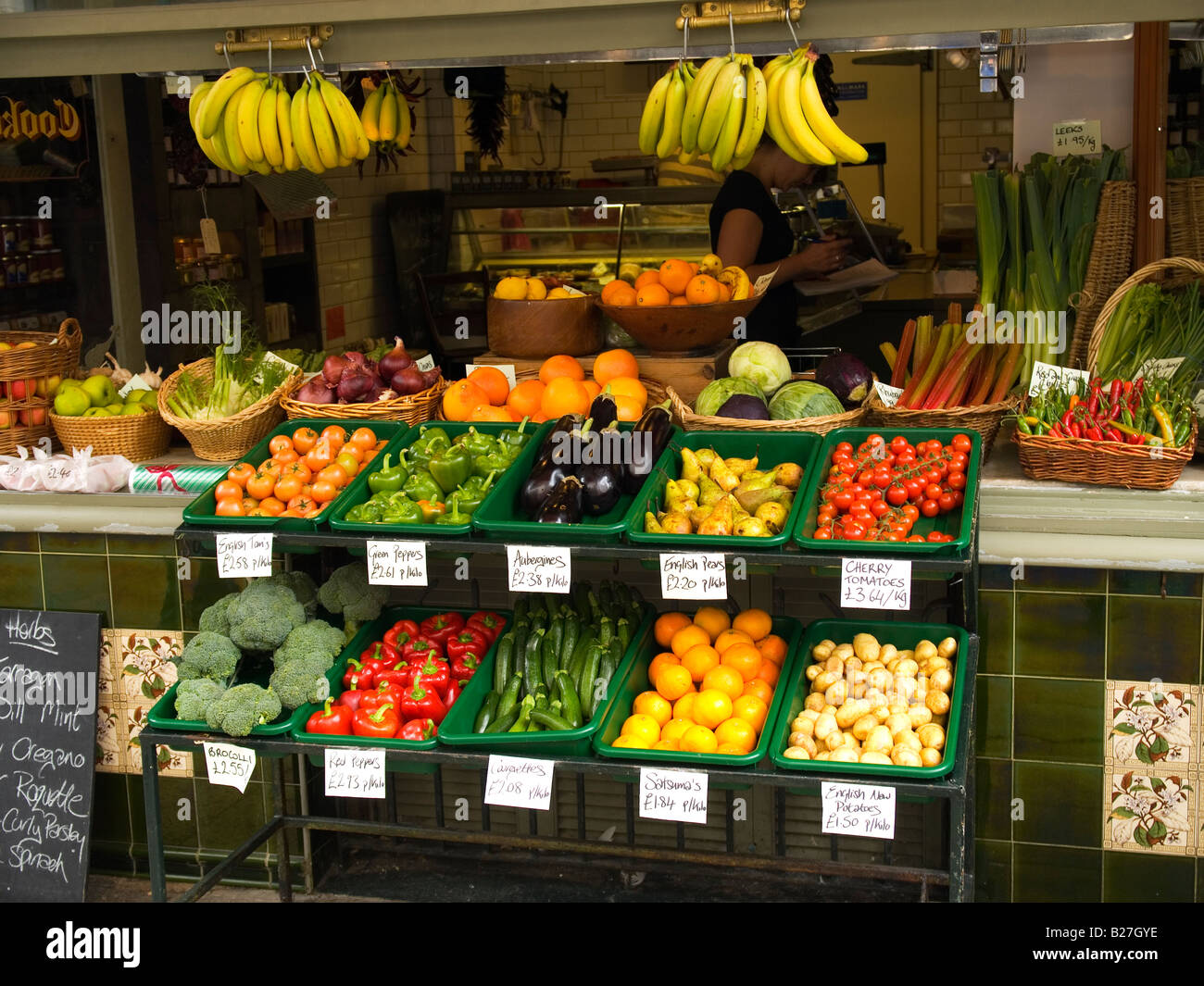 An Attractive Display Of Fruit And Vegetables In A Shop In