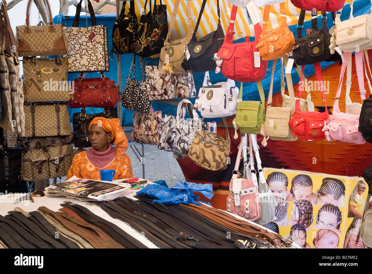 African woman selling handbags and leather belts on market stall Teror Gran  Canaria Spain 951d4e019123d