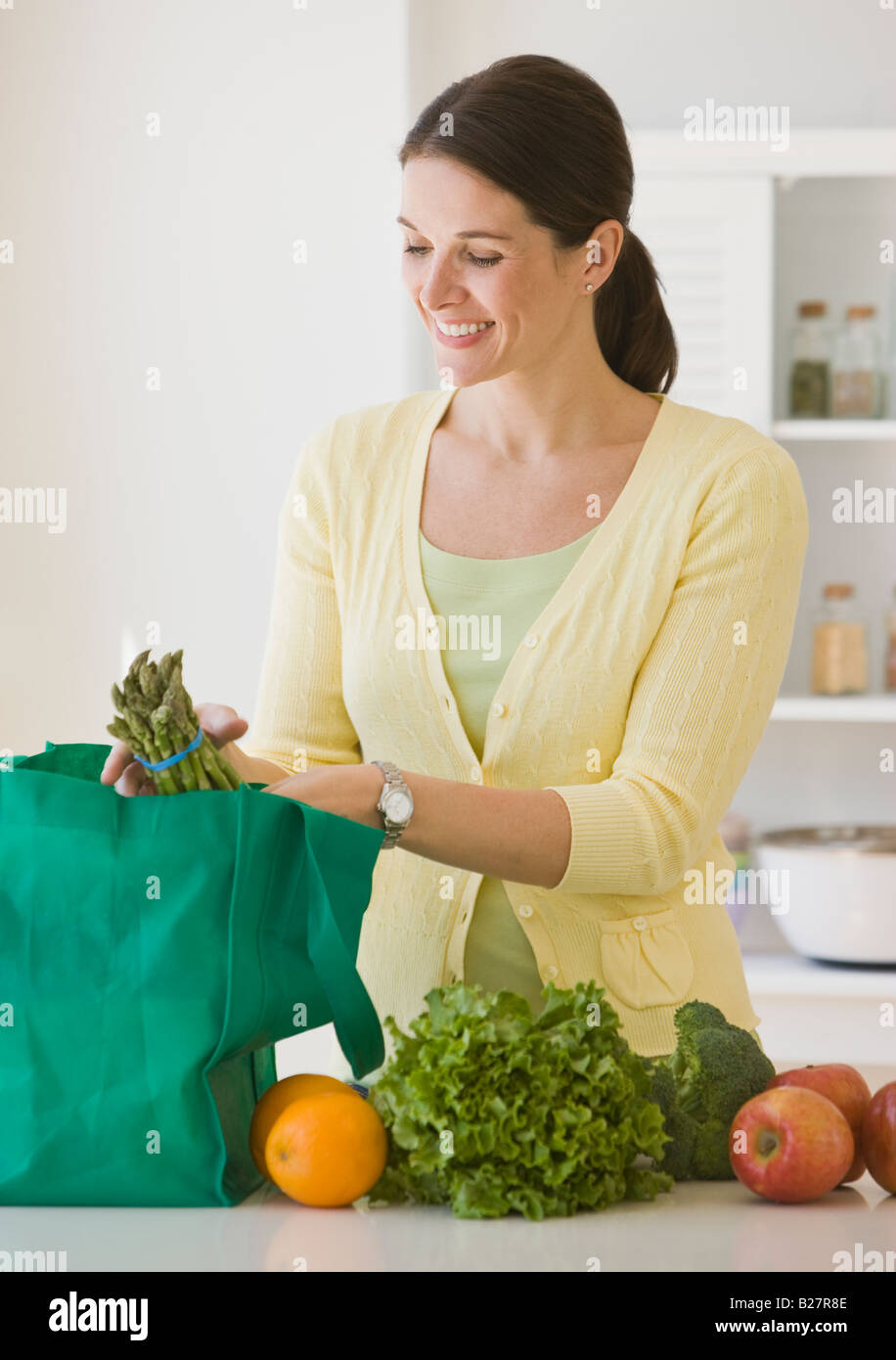 Woman unpacking groceries - Stock Image