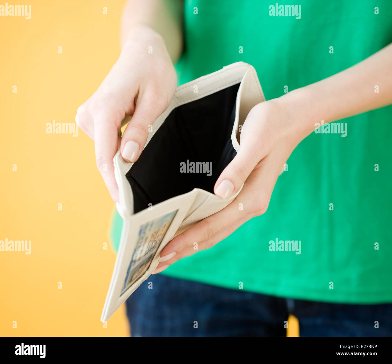 Woman holding open empty wallet - Stock Image