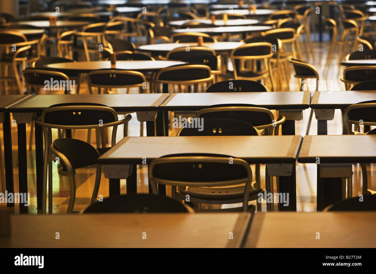 Empty tables and chairs - Stock Image