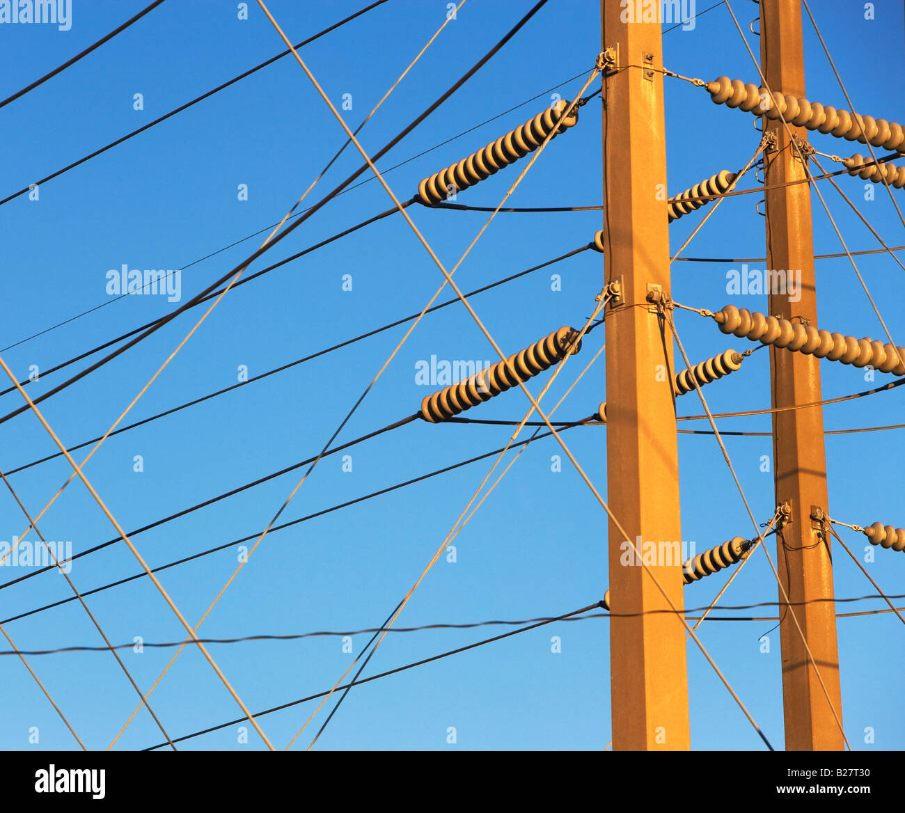 Low angle view of power lines on poles - Stock Image