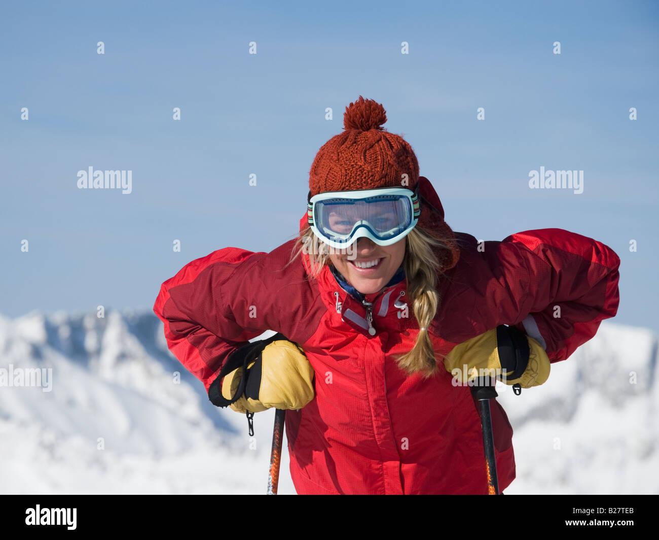 Woman wearing ski gear - Stock Image