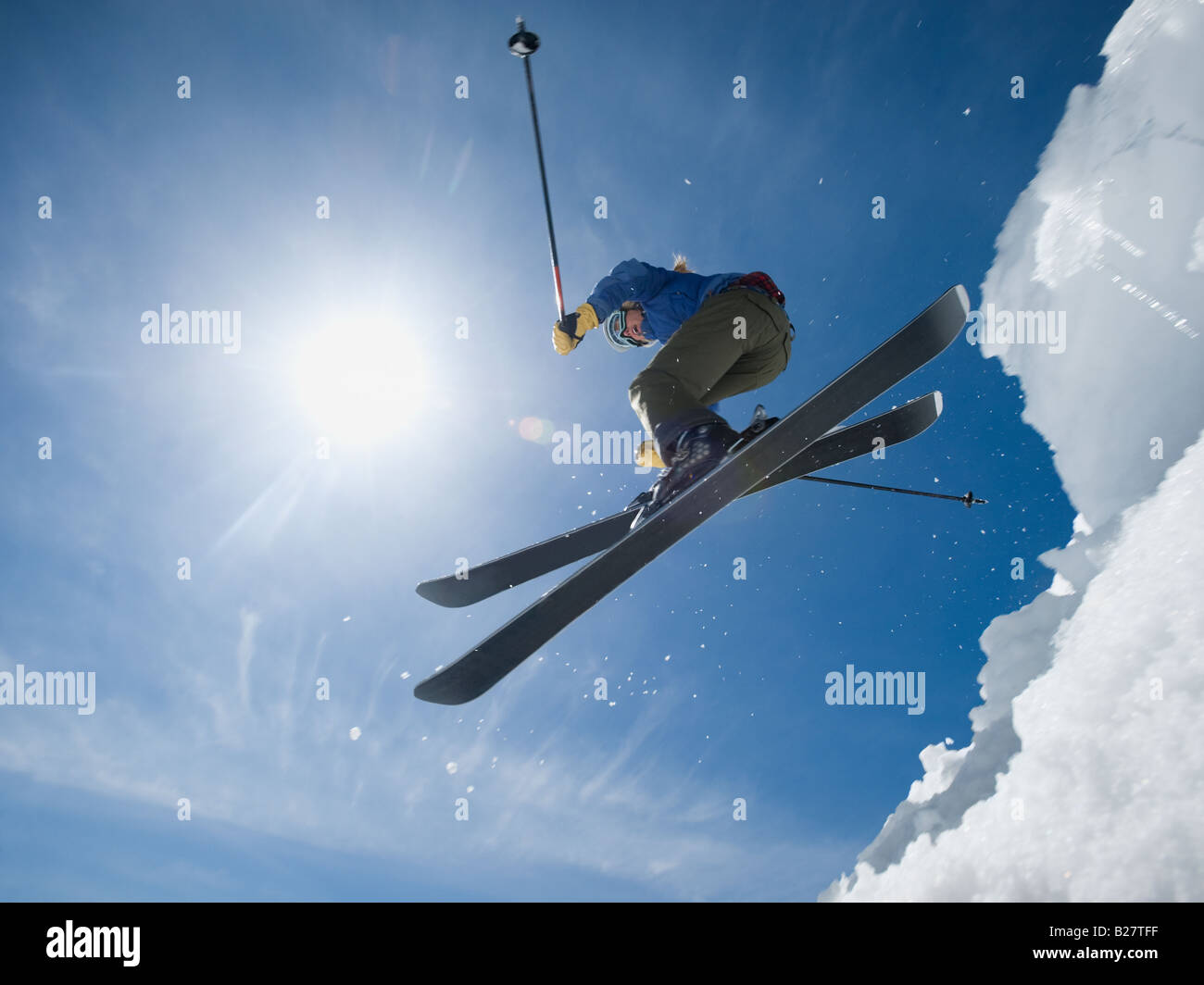Woman on skis in air Stock Photo