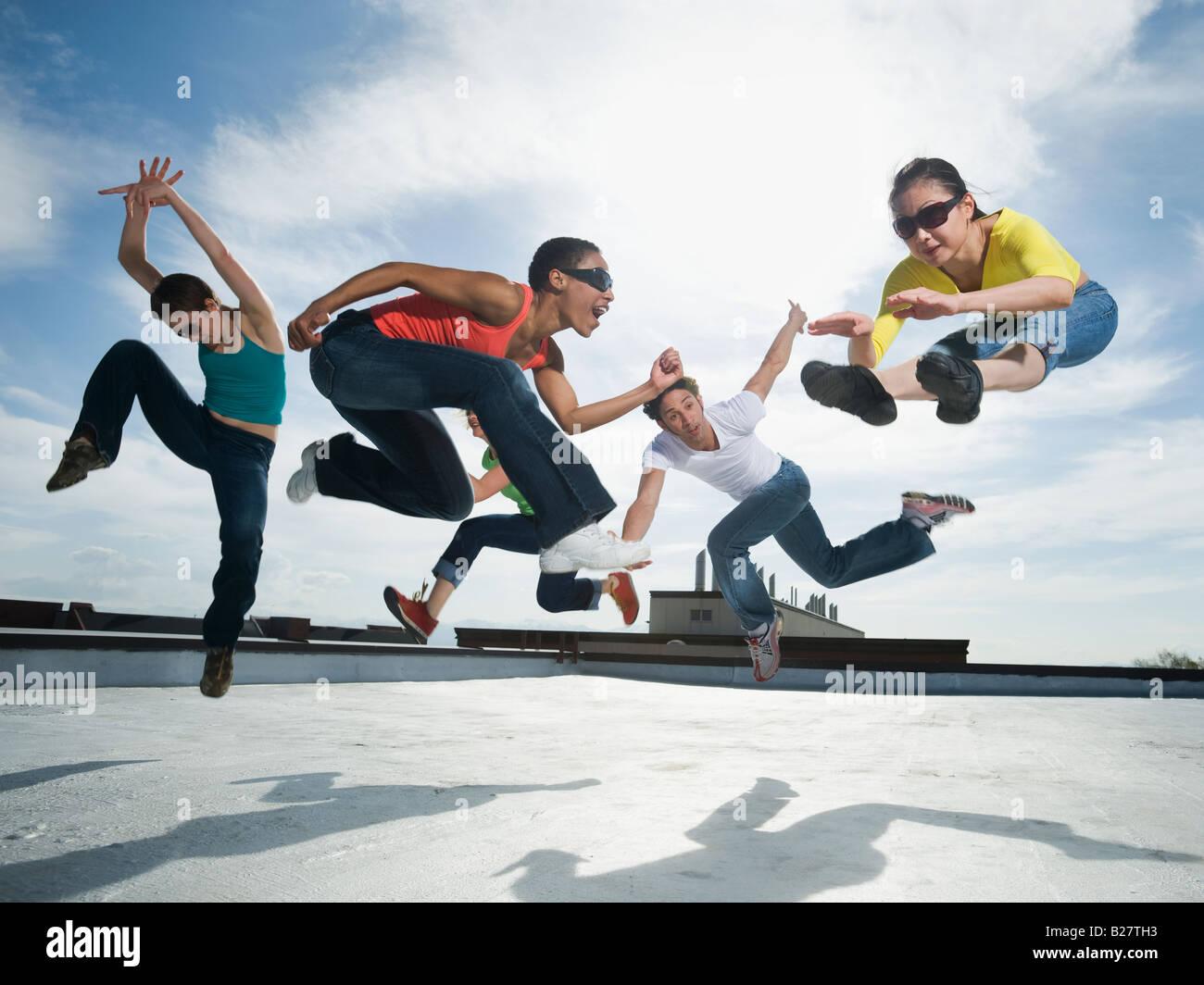 Multi-ethnic group performing modern dance - Stock Image