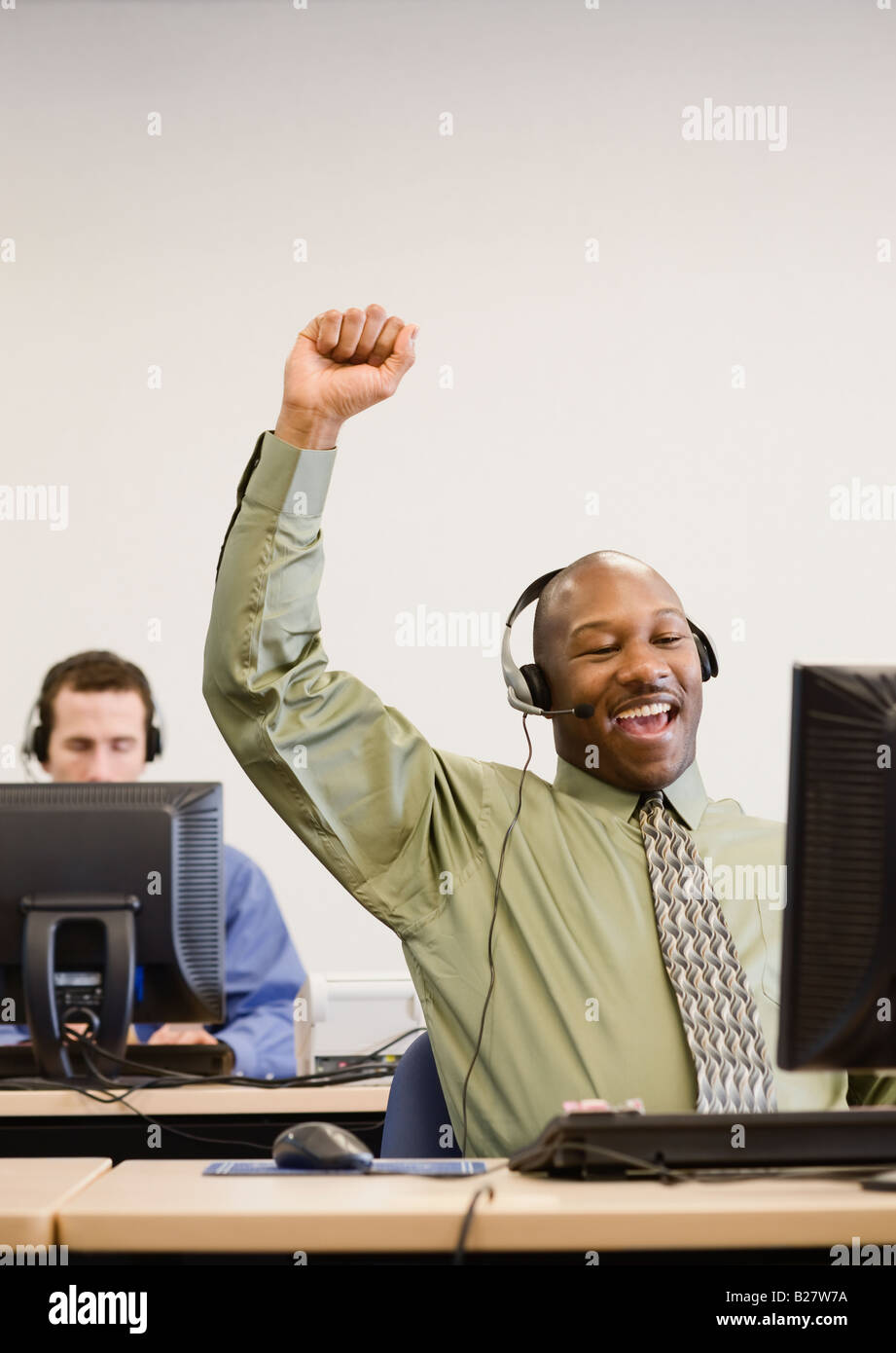African businessman cheering - Stock Image