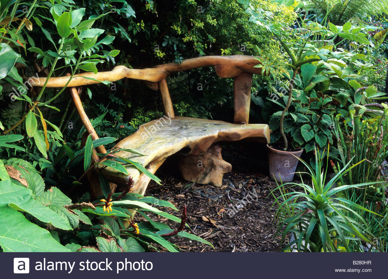 Waterford lane Hampshire sculptural wooden bench - Stock Image