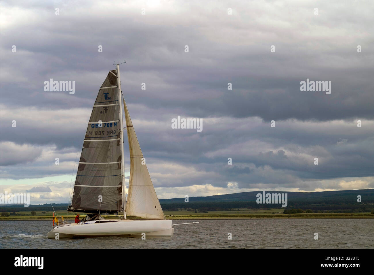Trimaran sailing in the Moray Firth off Chanonry Point, near Inverness in the Scottish Highlands. - Stock Image